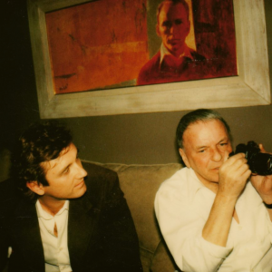 1980; NYC apt Mr. S giving Bobby Marx tips for his new camera, a birthday gift. POSTCARDS FROM A DREAM @ Amazon Copyright 2016 Janice Easterling Brustman