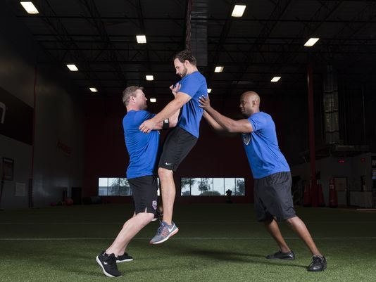 "We're not saying in theory this works; we're saying we know it works,"" former NFL lineman Scott Peters (left) says of his Safe Football method practicing with the Indianapolis Colts. (Photo: Joe Giannetti/Photographing Strength)"